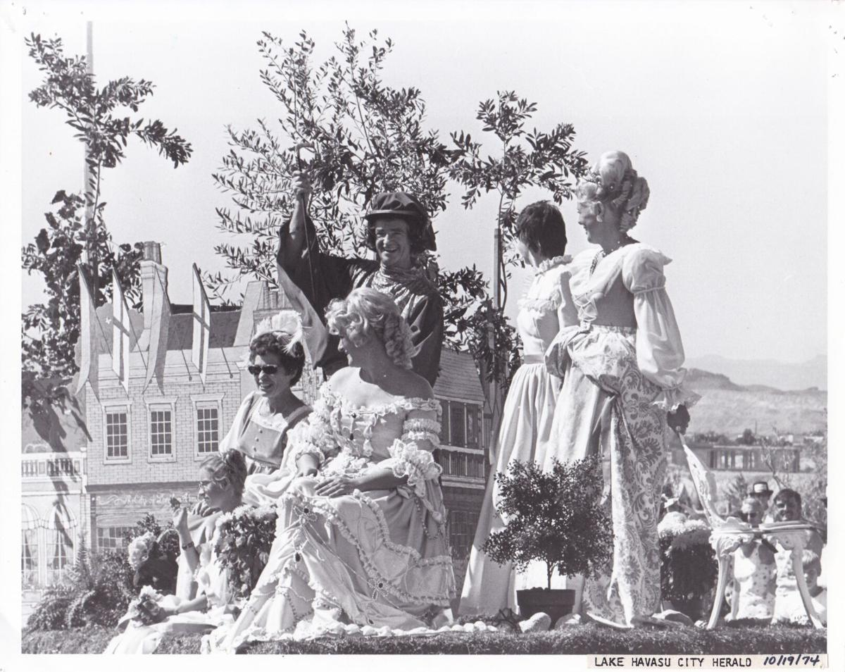 4 women and a man in elizabethan costume on parade float 10-19-74.jpg