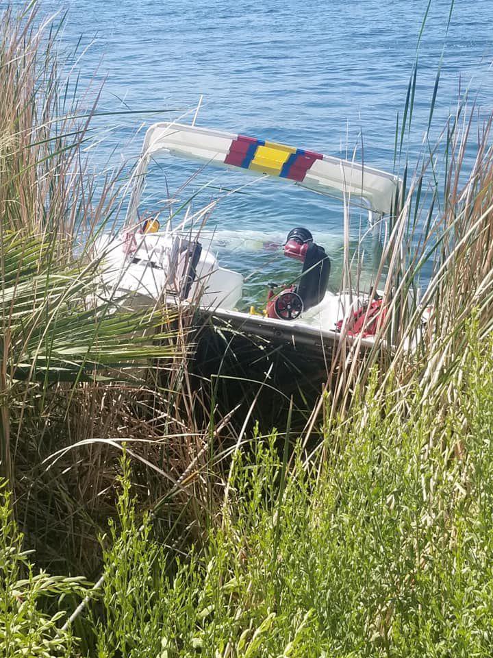 sunken buckskin boat.jpg