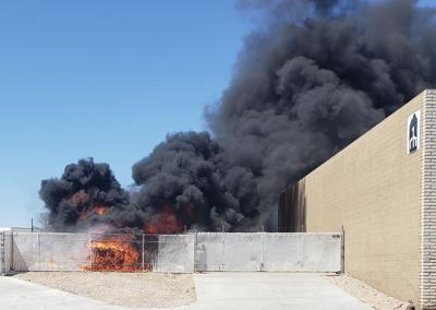 Fire outside of an Acoma Boulevard business