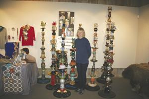 Linda Cota makes tall yard art from found items