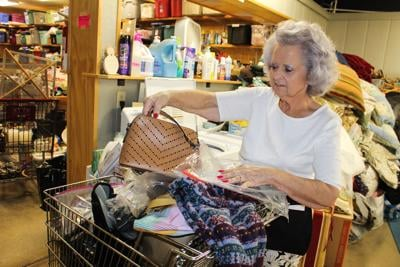 Thrift stores cautious, but open