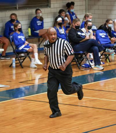 Referee back on court after beating COVID