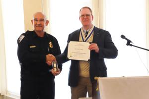 <p>CPISD PD Chief Jimmy Poole (left) receives the Law Enforcement Commendation MedaI from Chapter President Robert Smith.</p>