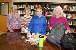 Locals work 'Backpack  Mission' to  immigrants