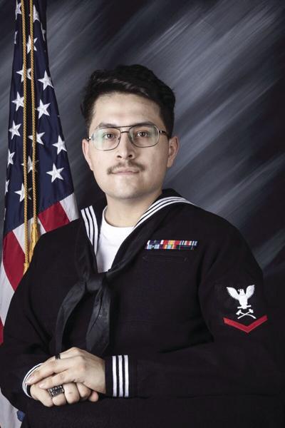 Nelms serving on USS Iwo Jima as petty officer