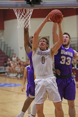 <p>Schreiner University's Blake Kelley goes up for a bucket Wednesday night against Mary Hardin Baylor.</p>