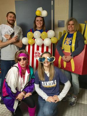 "<p>Daniels Elementary teachers Scott Carlson, Megan Ivey, Tammy Callcott, Christie Stanton and Jennifer Haas showcase prizes available for tickets sales for the school's ""Spring Fling"" scheduled for April 6.</p>"