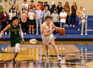 <p>Tivy's Jackson Young was limited to eight points Friday night after battling a night of double teams against San Antonio McCollum.</p>