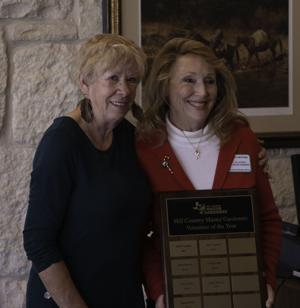 <p>Jackie Skinner (right) accepts the Hill Country Master Gardener's Volunteer of the Year Award, presented by last year's recipient, Linda Proffitt. </p>