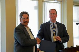 <p>Kerr County Sheriff Rusty Hierholzer, left, receives the Silver Good Citizenship Medal from Chapter President Robert Smith.</p>