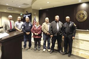 <p>City Council, led by Mayor Bill Blackburn, left, approved donation of a 2001 pumper truck from Kerrville Fire Department led by Chief Dannie Smith, right, to the Center Point Volunteer Fire Department; and CPVFD members, center, thanked the city for this gift.</p>