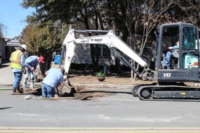 City road, utility crews work around the clock