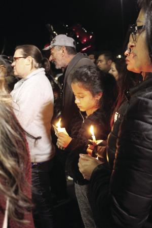 Family, friends host vigil for shooting victim