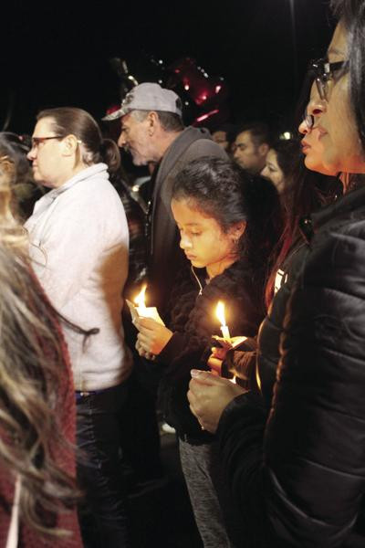 Family, friends host vigil for shooting victim
