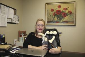 Donna Bueché  provides blankets  at Cancer Center