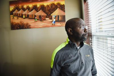 Wilmot Collins, 54, poses for a photograph in his Helena home Wednesday afternoon.