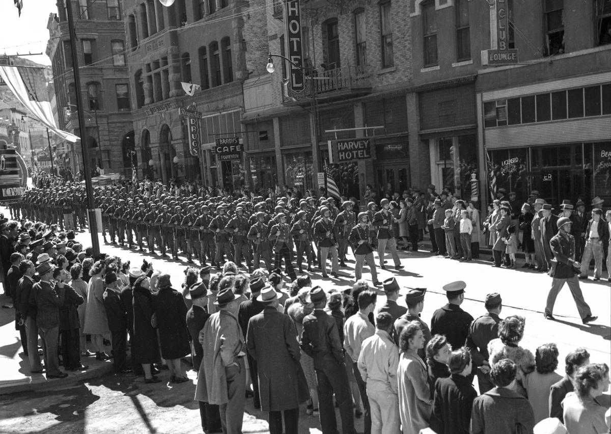 A parade of soldiers from the First Special Service Force march down Main St., now Last Chance Gulch, in April 1943 before their deployment to WWII.