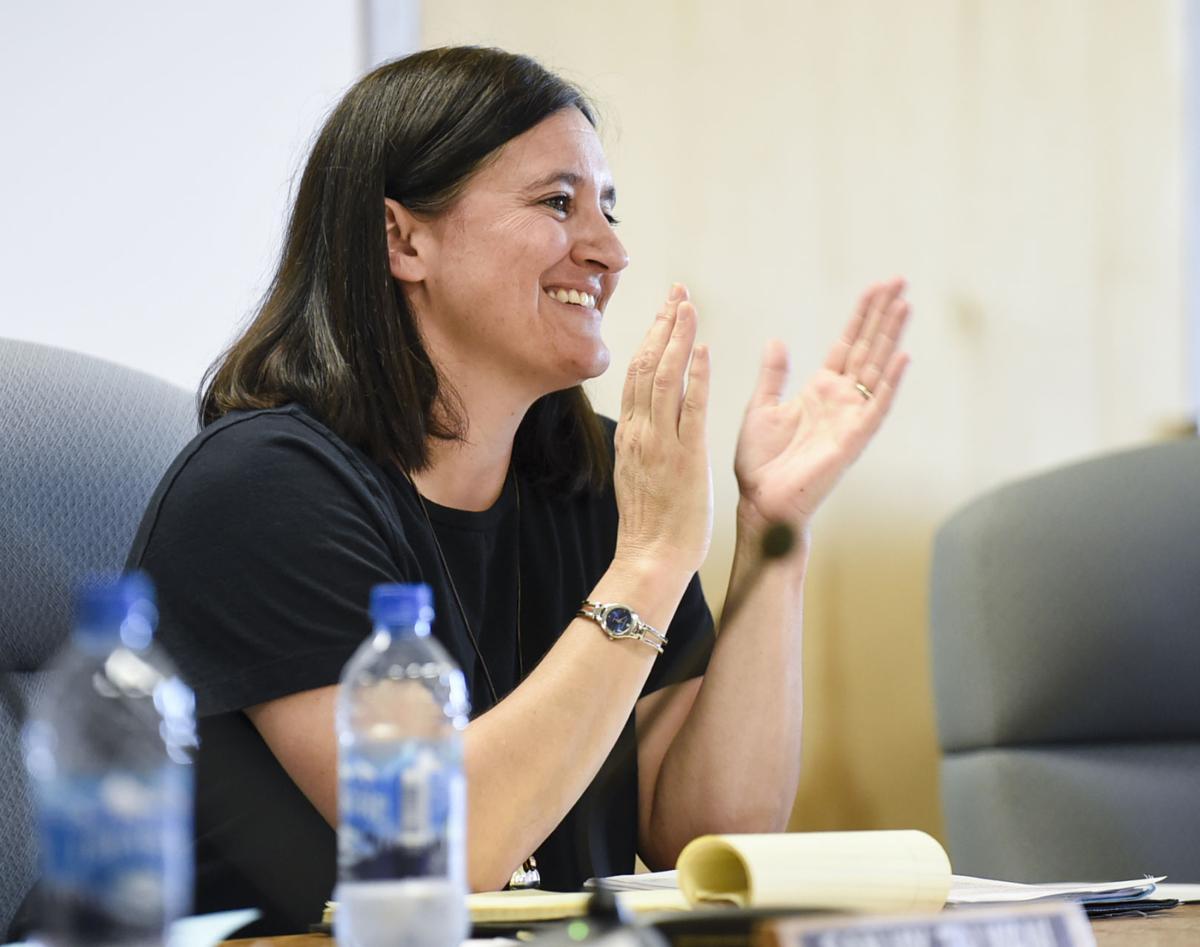 Trustee Sarah Sullivan claps during the school board meeting Tuesday night