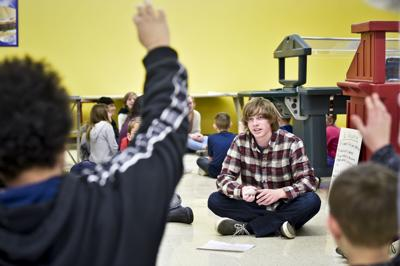 Capital High senior Isaac Marshall leads younger students