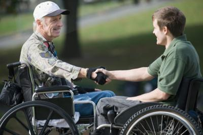 veterans disabled wheelchair disability accessibility handshake deal agreement greeting wounded warriors