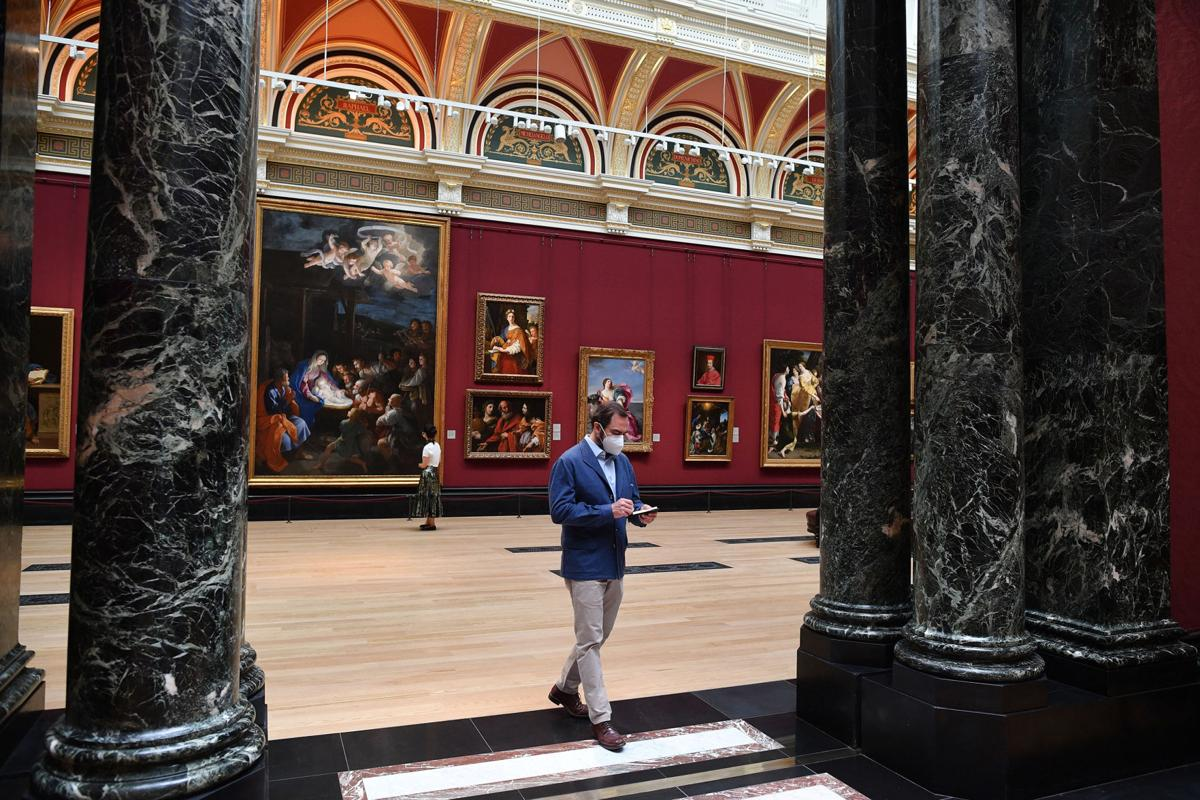 Members of staff and the media wearing protective face coverings move through a room inside the National Gallery on July 4, 2020, as the gallery prepares to reopen on July 8 following the easing of restrictions imposed during the novel coronavirus COVID-19 pandemic. English art galleries, museums and cinemas are able to open their doors from Saturday, July 4, as relaxations of the coronavirus restrictions continue.