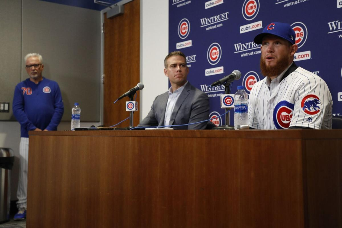New Cubs closer Craig Kimbrel speaks after he is introduced by Theo Epstein, as Cubs manager Joe Maddon looks on, at Wrigley Field on June 7, 2019.