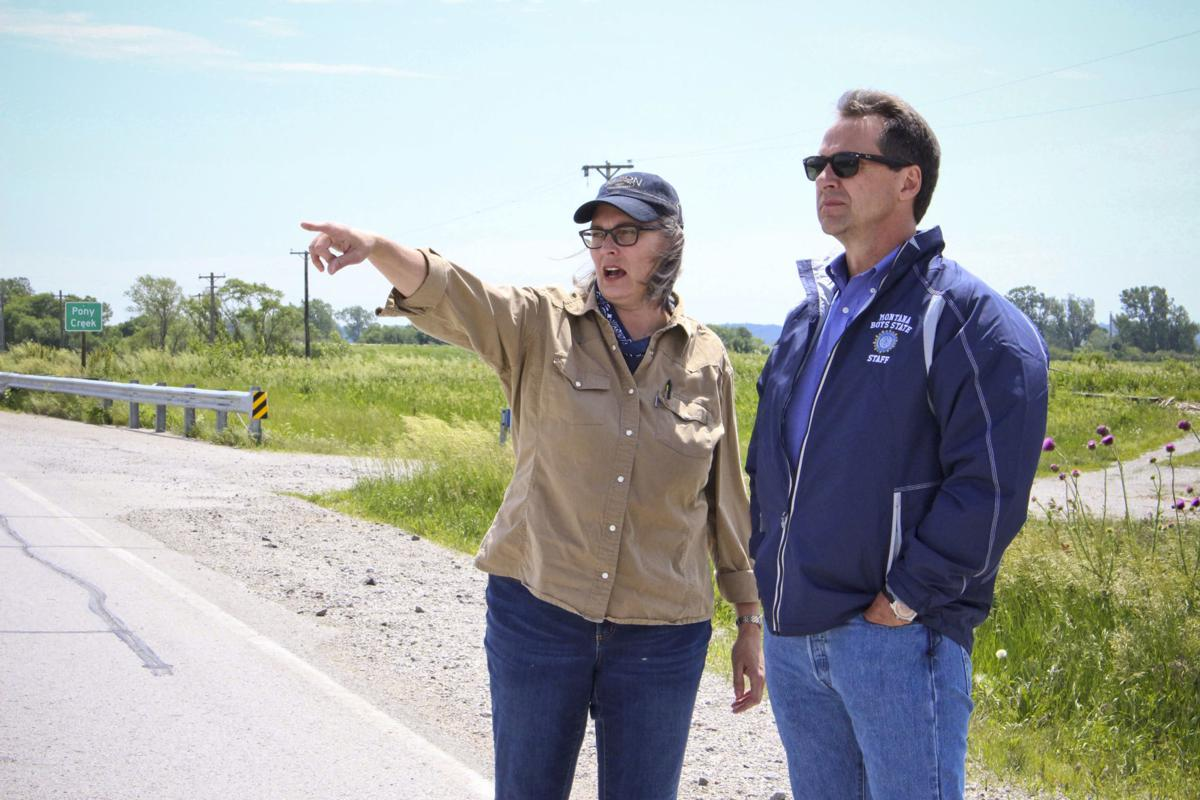 Democratic Presidential Candidate Gov. Steve Bullock, right, tours flood-affected Iowa