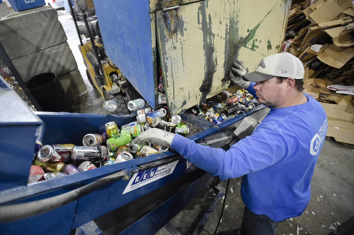Josh Pocha runs recycled cans through a separator