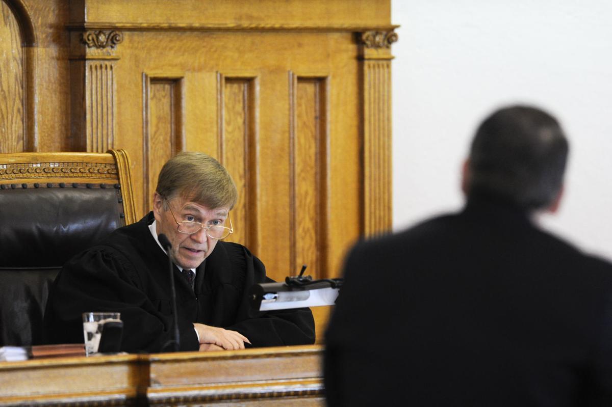 District Court Judge Ray Dayton, left, responds