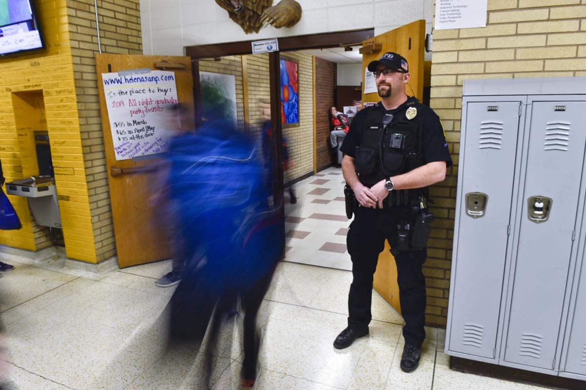 Capital High students move from class to class around School Resource Officer Andrew Barton in this file photo from 2019.