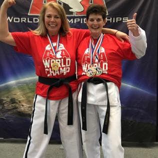 Frederick, Benner defend World martial arts titles