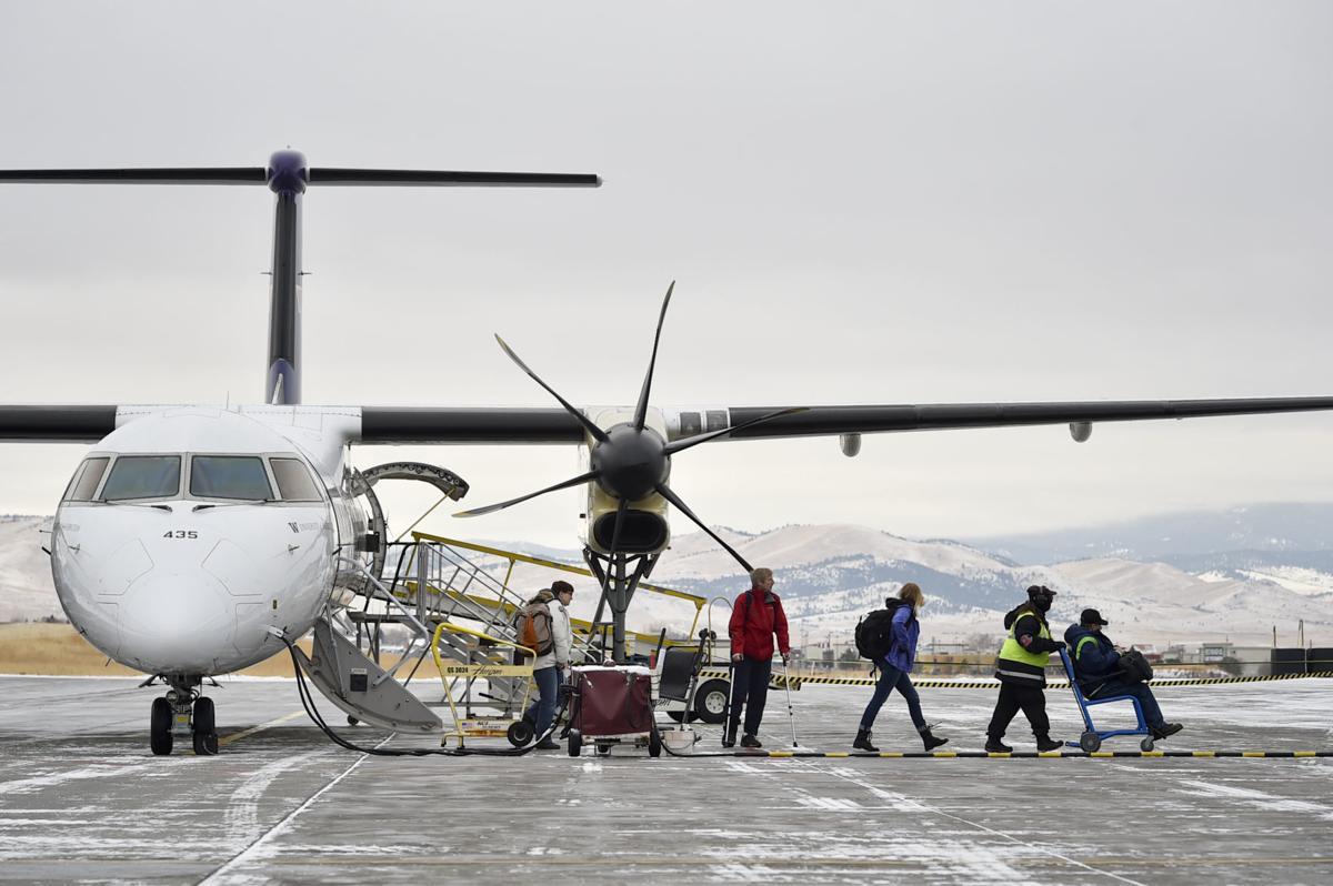 Passengers de-board an Alaska Airlines flight at the Helena Regional Airport Thursday.