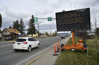 An automated sign warns Montana Ave. drivers