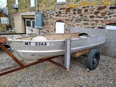 "This fishing boat along with ""desks, chairs, file cabinets, tables and shelves"" will be sold at Thursday's county garage sale."