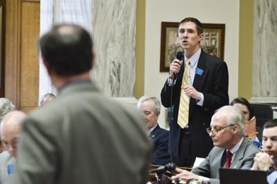Rep. Zach Brown, D-Bozeman, right, debates House Majority Whip Derek Skees, R-Kalispell,