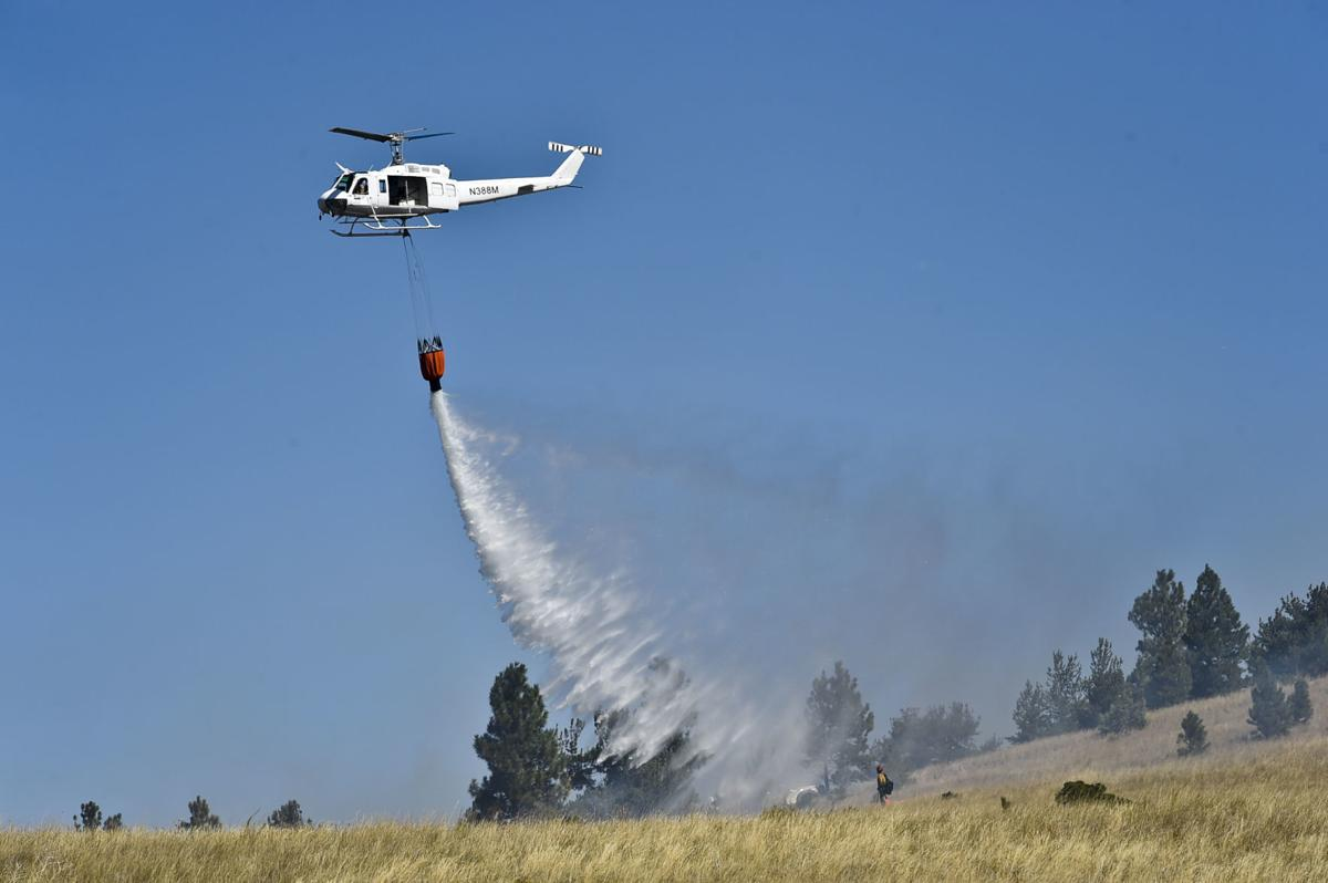 Firefighters attack multiple fires along Birdseye Rd. Wednesday afternoon.