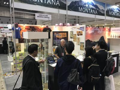 A Lewis and Clark Brewing Co. representative networks at a trade show in Japan