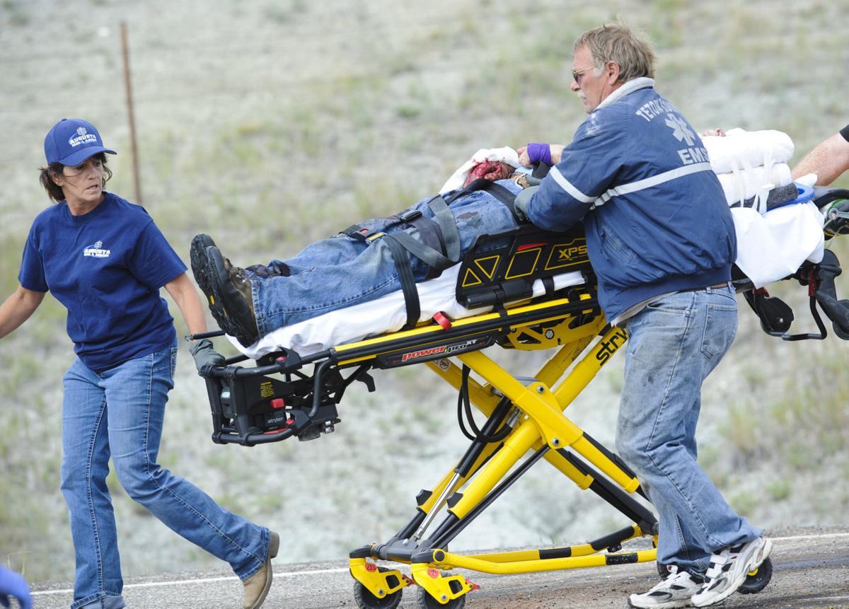 Volunteer paramedics rush a victim