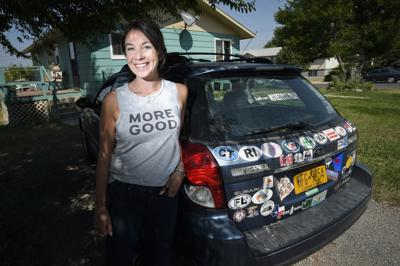 Mary Latham, poses next to her mother's old car