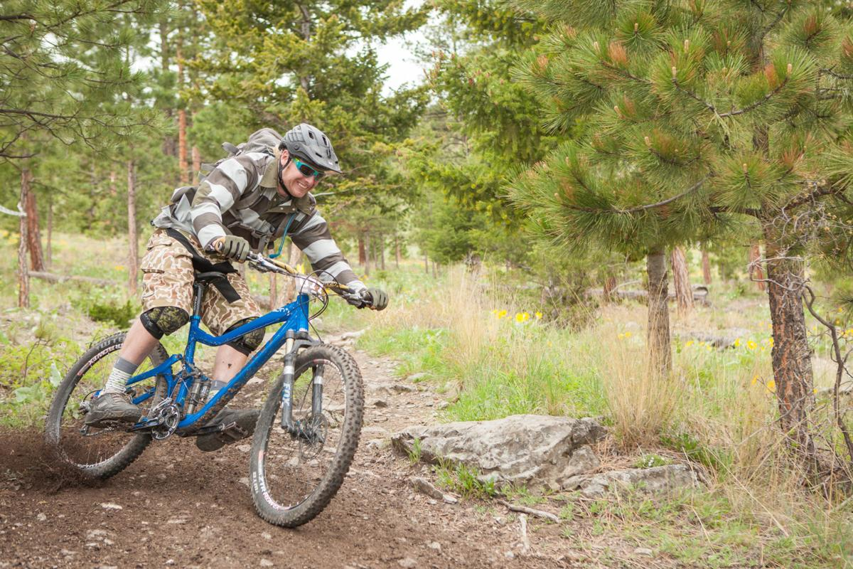 A biker rides the Mount Helena Ridge trail