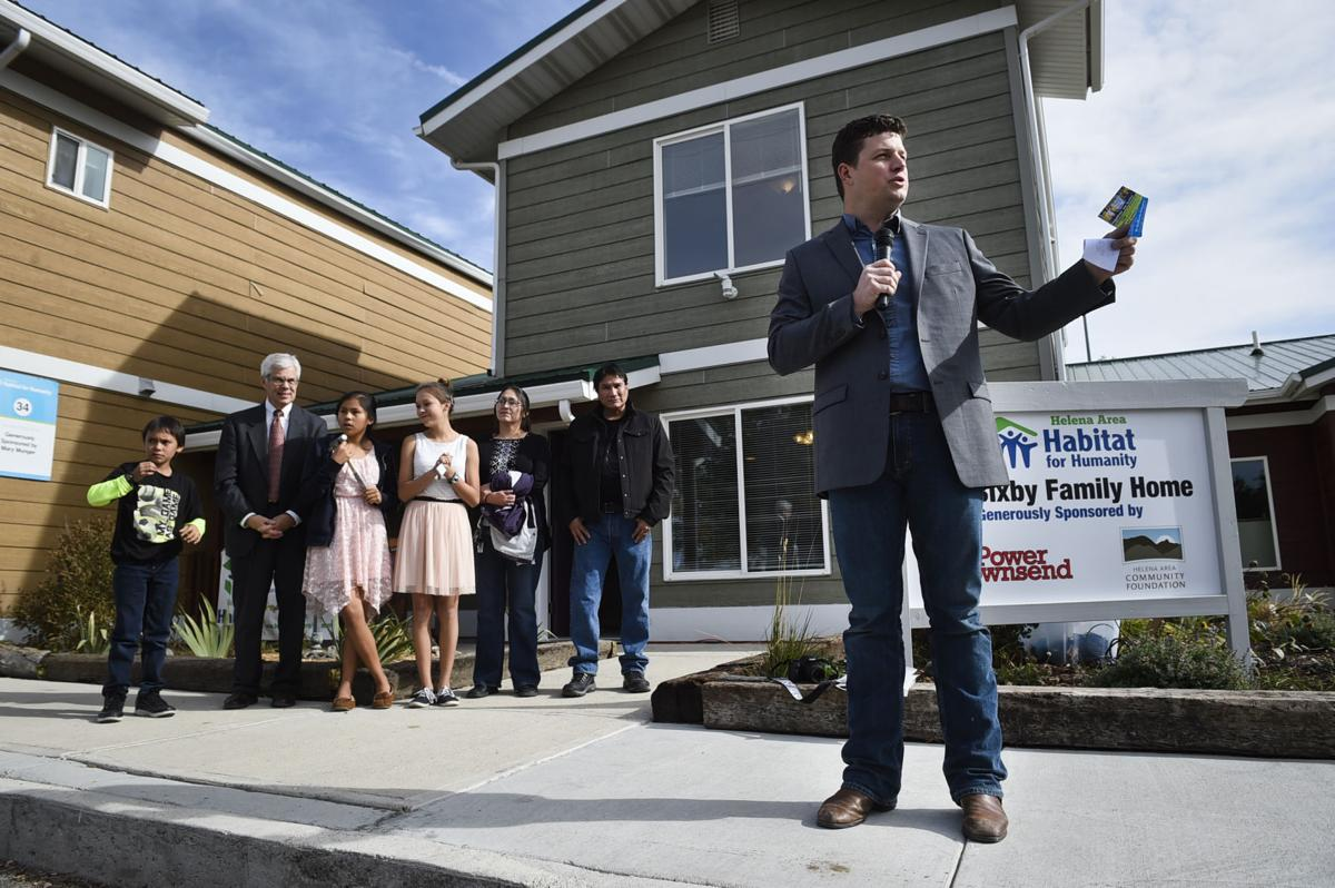 Jacob Kuntz, executive director of the Helena Area Habitat for Humanity, tells a story about the Bixby family Tuesday morning during the key ceremony for the family's new home.