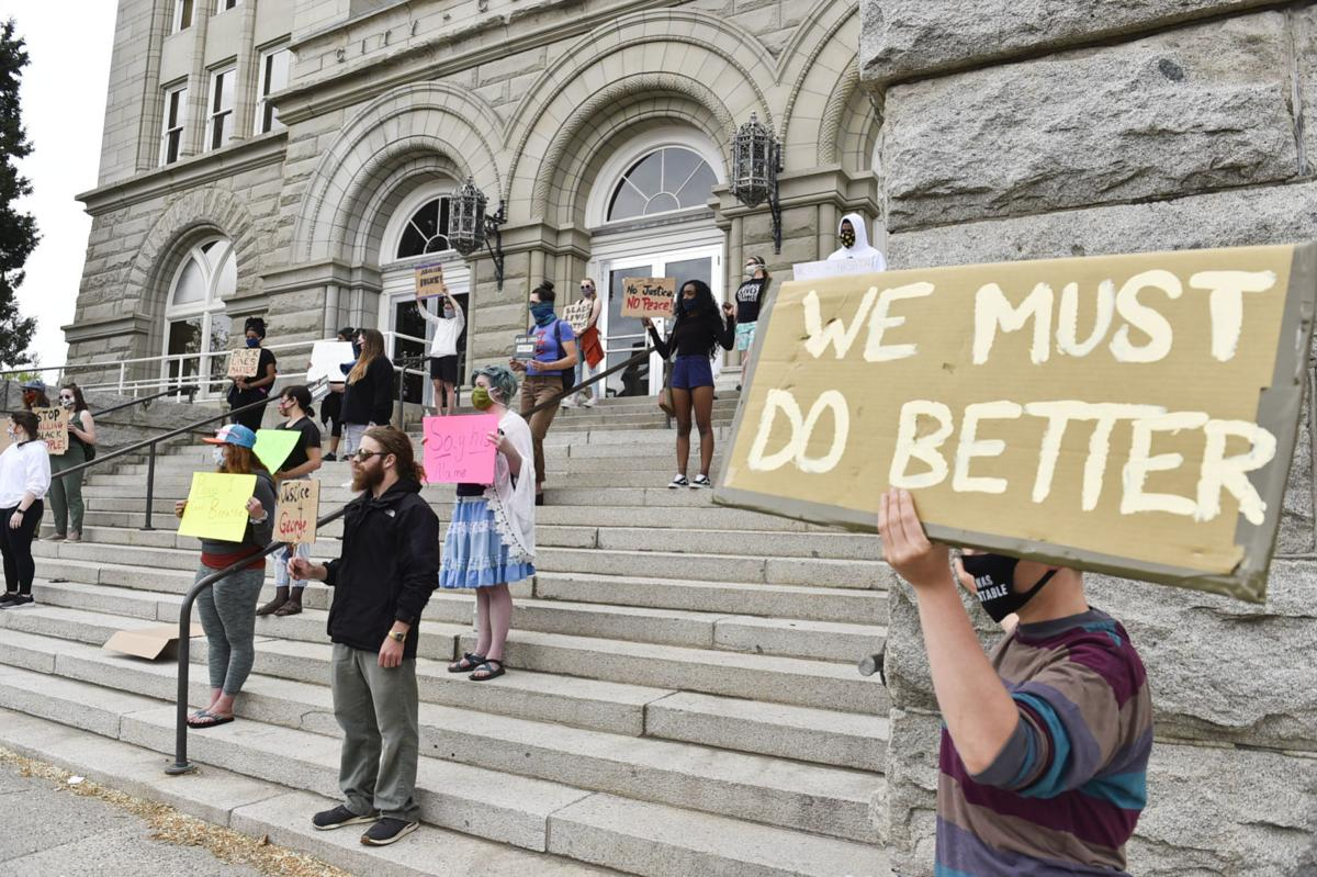 Protesters gather on the steps of the City-County Building Friday