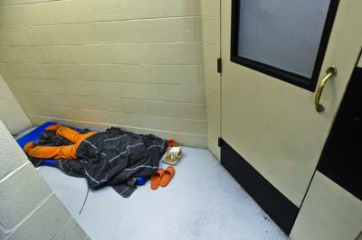 An inmate sleeps in a hallway outside an attorney meeting room in the Lewis and Clark County Detention Center (copy)