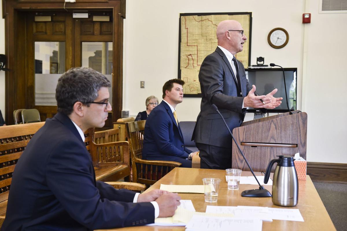 Jim Meloy, at podium, argues on behalf of Gov. Steve Bullock
