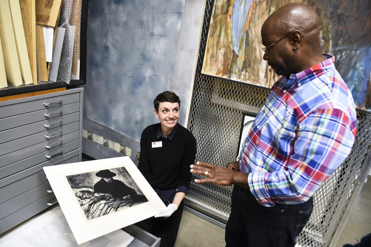 Mayor-elect Wilmot Collins, right, and Holter Museum of Art assistant curator Jennifer duToit-Barrett look through some of the printmaking work of James Todd in the museum's vault Wednesday morning.