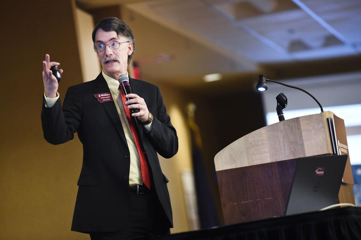 Patrick Barkey, director of the Bureau of Business and Economic Research, gives a Helena specific economic outlook presentation Tuesday at the 2018 Economic Outlook Seminar at the Great Northern Best Western.