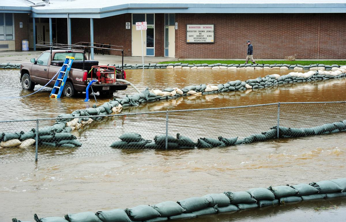 A series of sandbag dikes saves Rossiter Elementary School from flood waters in this IR file photo.