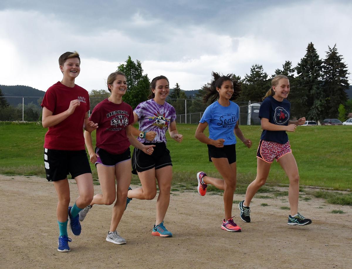 Helena High track teammates