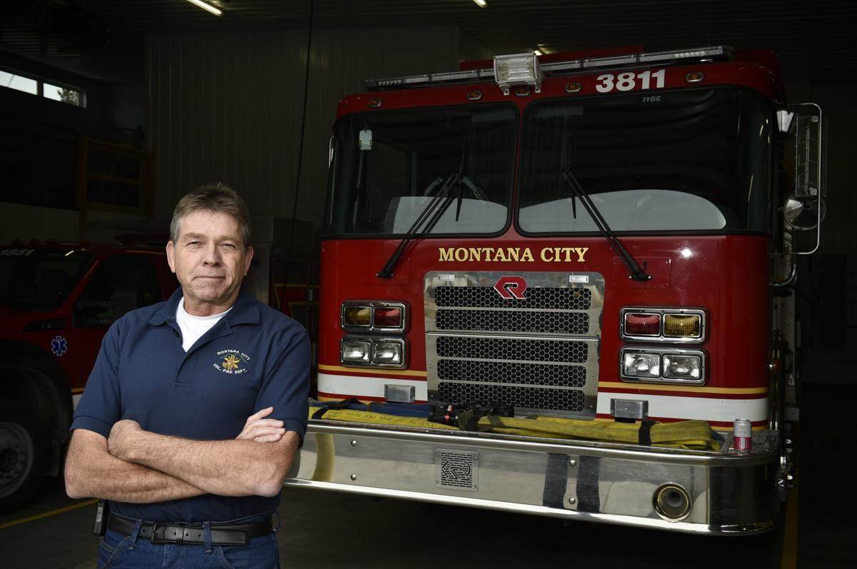 Retired Montana City Fire Chief Rick Abraham poses for a photo