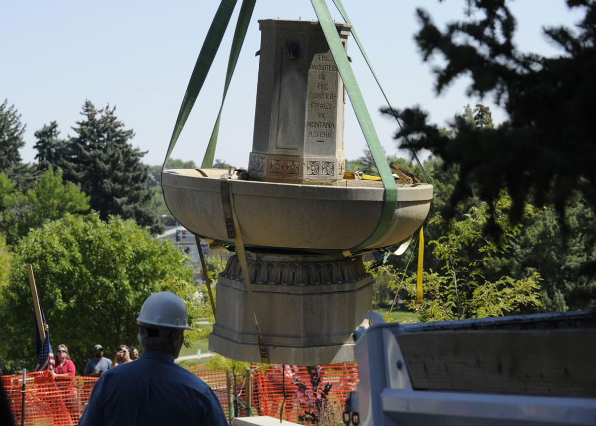 People gather at the controversial Confederate Fountain in Hill Park on Aug. 18, 2017 as city employees, under police guard, remove the fountain.